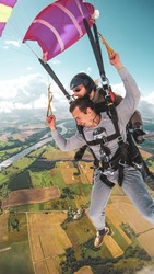 tandem skydive landing with open parachute