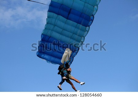 Tandem skydiver with parachute open