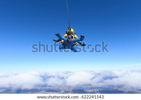 tandem skydiving. above the...