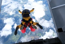 Tandem skydiving. Skydivers are jumping out of a plane.