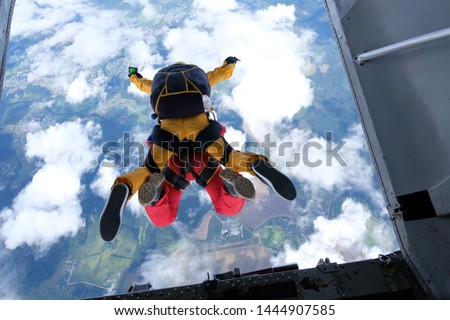 Tandem skydiving. Skydivers are jumping out of a plane. Stock photo ©