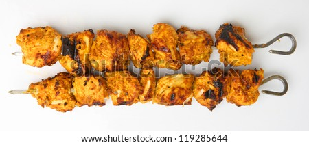 Tandoori chicken tikka on kebab skewers