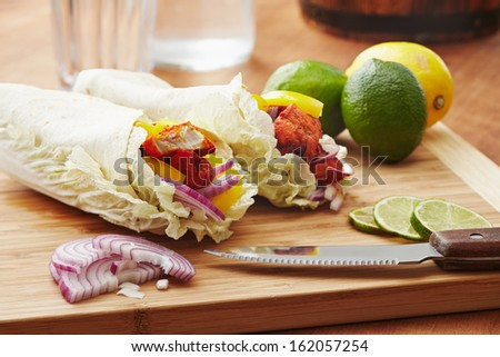tandoori masala spiced tortilla wraps with lettuce, peppers, lime and onion