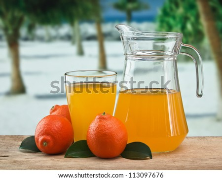 tangerine and juice on a beach table