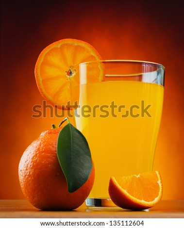 tangerine and juice on a table