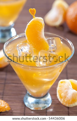 Tangerine cocktail on dark wooden table top
