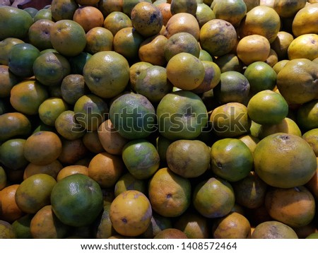 Tangerine. Honey Mandarin Tangerines. Fresh Picked Tangerines tangerines in the market as a background.  #1408572464