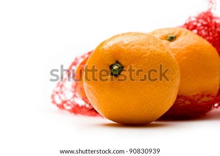 Tangerine in a net on white