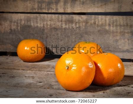 Tangerine, Mandarin honey orange on old vintage table with copy space