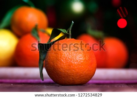 Tangerine or clementine with green leaf. Tangerines - oranges, mandarins, clementines, citrus fruits with leaves #1272534829