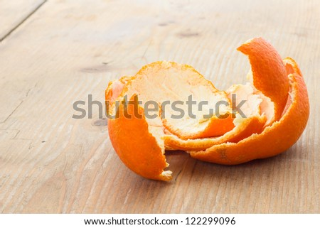 Tangerine peel on the table in front of a window
