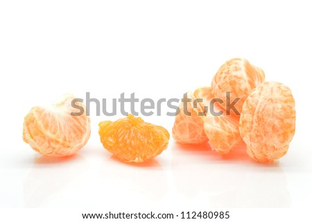 Tangerine slices on a white background close-up