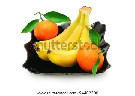 Tangerines and banana in a plate isolated on white background