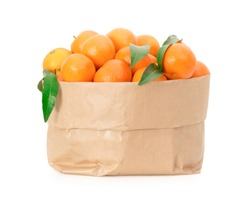 Tangerines in a paper bag isolated on white background