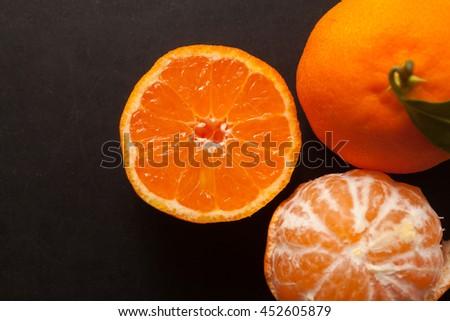 Tangerines on black background #452605879