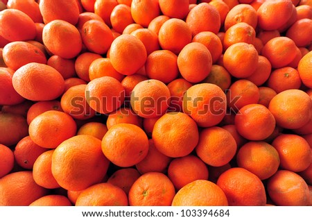 Tangerines on display in the market.