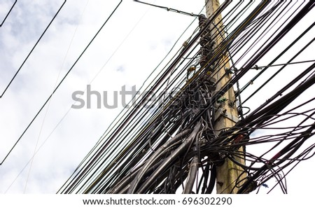 Tangle of Electrical Wires on Power Pole,dangerously #696302290
