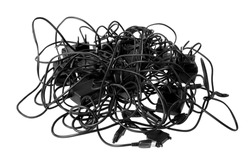 Tangled cables and connectors illustrating complex problems and obstacles.