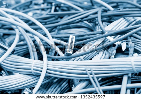 Tangled wires, many power cables in datacenter, cabling mess in server room, closeup #1352435597