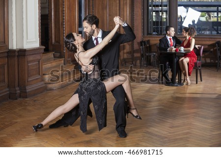 Tango Dancers Performing While Couple Dating In Restaurant #466981715