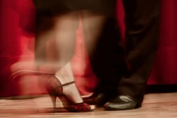 Tango steps, shoes with blurred movement