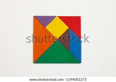 Tangram. Traditional Chinese dissection puzzle, seven tiling pieces - geometric shapes: triangles, square (rhombus), parallelogram. Board game for kids that helps to develop analytical skills. #1144001273