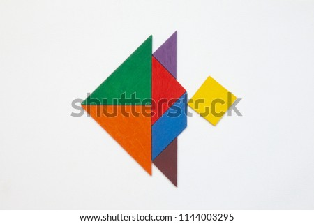 Tangram. Traditional Chinese dissection puzzle, seven tiling pieces - geometric shapes: triangles, square (rhombus), parallelogram. #1144003295