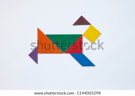Tangram. Traditional Chinese dissection puzzle, seven tiling pieces - geometric shapes: triangles, square (rhombus), parallelogram. #1144003298