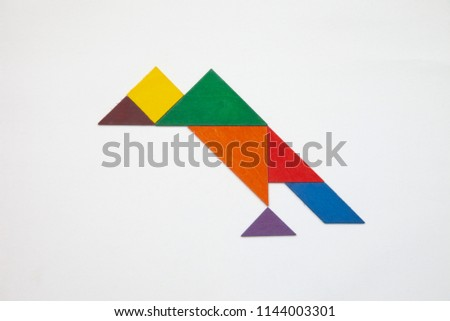 Tangram. Traditional Chinese dissection puzzle, seven tiling pieces - geometric shapes: triangles, square (rhombus), parallelogram. #1144003301