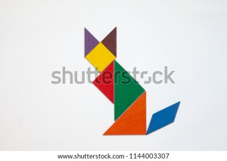 Tangram. Traditional Chinese dissection puzzle, seven tiling pieces - geometric shapes: triangles, square (rhombus), parallelogram. #1144003307