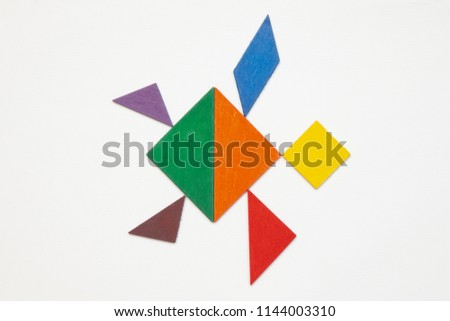 Tangram. Traditional Chinese dissection puzzle, seven tiling pieces - geometric shapes: triangles, square (rhombus), parallelogram. #1144003310