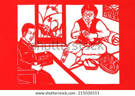 TANGSHAN CITY - AUGUST 28: Chinese paper-cut works on white background in a shop, on august 28, 2014, Tangshan City, Hebei Province, China