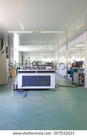TANGSHAN CITY - MAY 28: Large ink jet printers in a production workshop, on may 28, 2014, Tangshan city, Hebei Province, China
