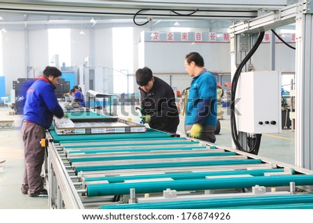 TANGSHAN - DECEMBER 22: Machinery and equipment in the workshop, in a solar equipment manufacturing enterprises on december 22, 2013, tangshan, china.
