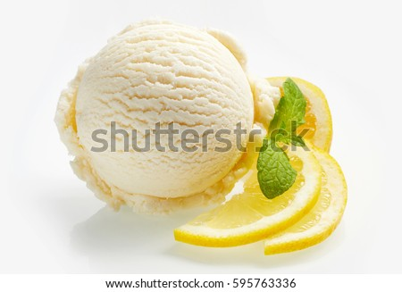 Tangy fresh lemon citrus sorbet or ice cream with sliced fresh fruit garnished with mint alongside over a white background