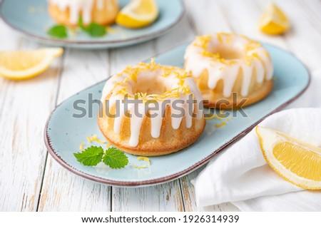 Tangy mini lemon bundt cakes topped with lemon glaze ストックフォト ©