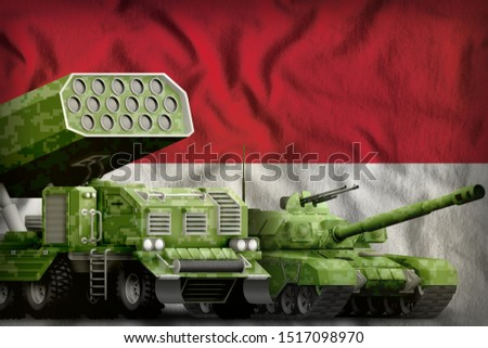 tank and missile launcher with summer pixel camouflage on the Indonesia flag background. Indonesia heavy military armored vehicles concept. 3d Illustration