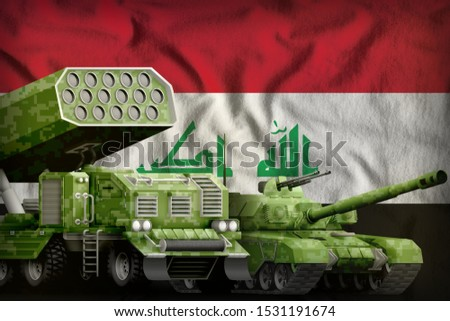 tank and rocket launcher with summer pixel camouflage on the Iraq flag background. Iraq heavy military armored vehicles concept. 3d Illustration