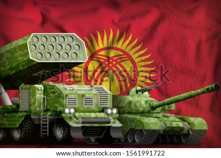tank and rocket launcher with summer pixel camouflage on the Kyrgyzstan flag background. Kyrgyzstan heavy military armored vehicles concept. 3d Illustration
