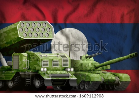 tank and rocket launcher with summer pixel camouflage on the Lao People Democratic Republic flag background. Lao People Democratic Republic heavy military armored vehicles concept. 3d Illustration
