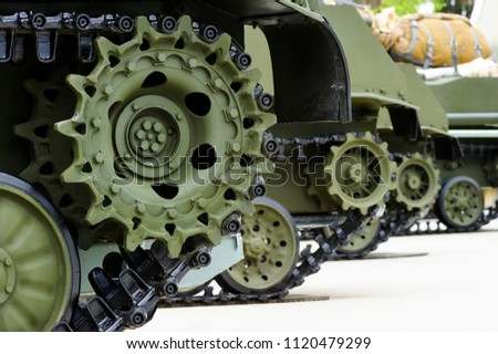 Gears and Track, wheel tank green Images and Stock Photos