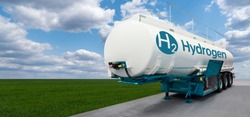Tank trailer with hydrogen on the background of a green field and blue sky. Renewable energy