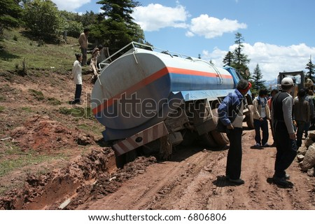 Tank truck stuck in the mud on a Chinese road