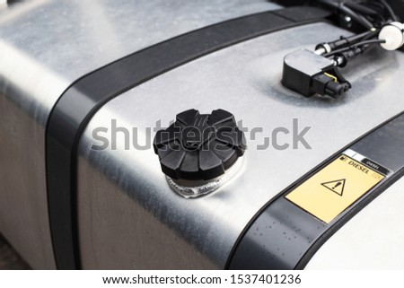 Tank with diesel fuel of a truck. Fuel economy concept while driving, modern fuel economy system, copy space #1537401236