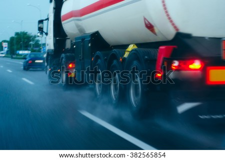 tanker on the move/tanker traveling on a wet road