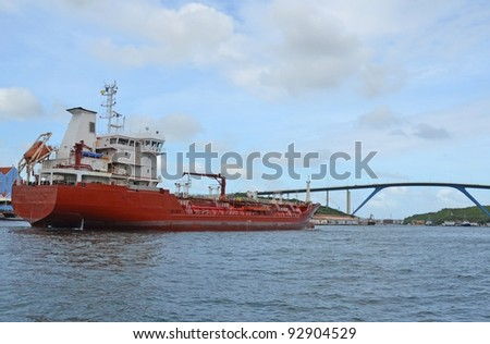 Tanker ship entering Port of Willemstad , Konigin Juliana Bridge in the background  Curacao