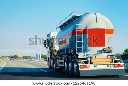 Tanker storage truck in the asphalt highway in Poland. Business industrial concept. #1225461190