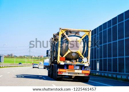 Tanker storage truck on the asphalt highway road in Poland. Business industrial concept. #1225461457