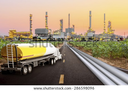 Tanker truck and oil pipeline for transport fuel on the highway to petrochemical oil refinery in sunrise