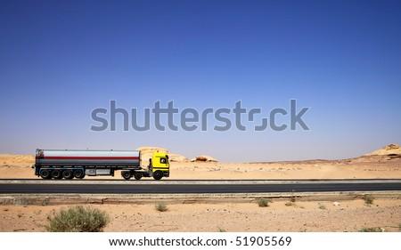 Tanker truck drive on highway at desert